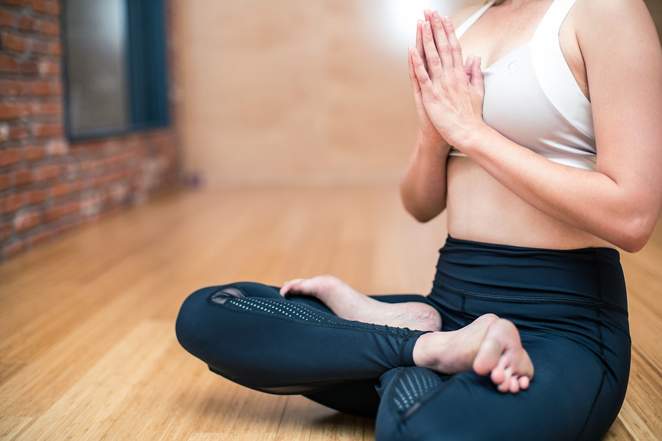 Woman practicing yoga to reduce and for exercise